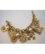 Heavy gold tone charm bracelet with faux pearls. - $24.00