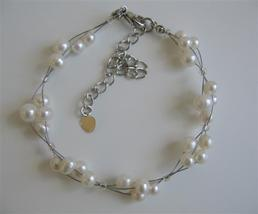 Freshwater Pearls Off White Pearls 3 Stranded Wire Bracelet - $11.43