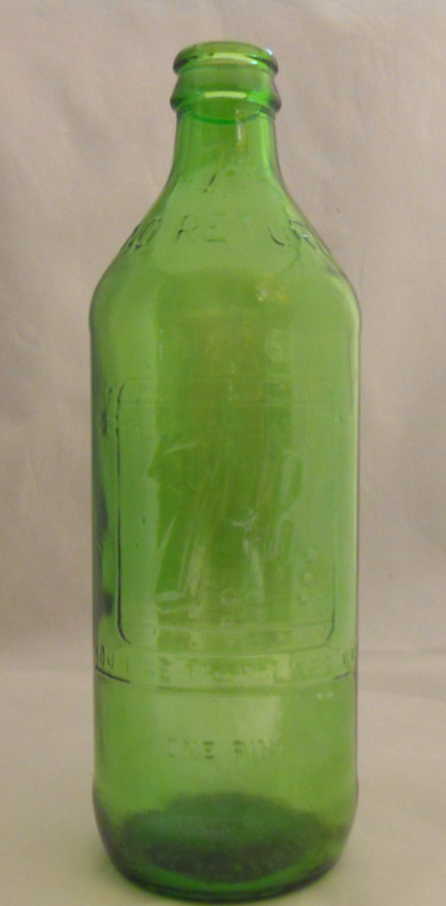 1969_vintage_7_up_embossed_green_bottle_you_like_it_it_likes_you_armstrong_co.