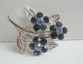Sapphire Crystals Flower Brooch with Cubic Zricon On Stem & Leaf - $9.48