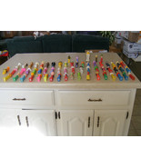 57 pieces of regular size Pez Collection  plus 4 small size once - $43.56