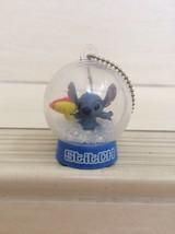 Disney Stitch Experiment In Mini Globe figure keychain. rare item - $18.00