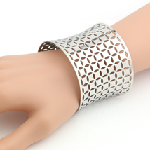 UNITED ELEGANCE Edgy Silver Tone Cuff Bracelet With Contemporary Cut Out... - $14.99