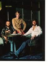 Bee Gees teen magazine pinup clipping sitting at a table for dinner time - $3.50