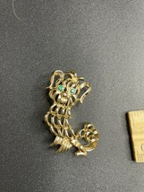 Vintage Costume Jewelry AVON Pin/Brooch Dog With Green Eyes Rhinestone - $9.49
