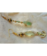 Ever Afloat earrings: Hawaiian sea glass wrapped in golden wire, anchor ... - $43.00