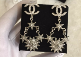 AUTHENTIC CHANEL 2015 CC LOGO STAR CRYSTAL DANGLE EARRINGS SILVER RARE