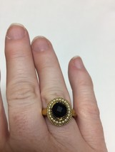 goldtone ring with black stone and faux pearls adjustable sizes 7-9 Avon - $9.90