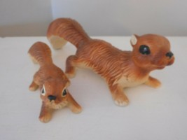 Vintage set of 2 Porcelain Baby / Adult Squirrel Figurines - $29.69