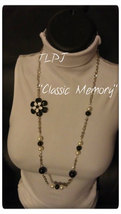 """Classic Memory: Black and white glass pearl with metal flower offset, 30"""" - $30.00"""