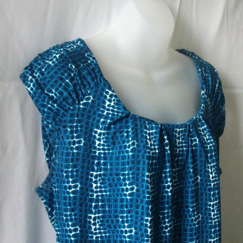 New George cap sleeve top in teal, white and black, size large