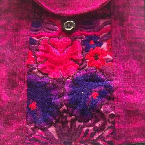 Deep pink cotton bag with embroidered front and button fastening