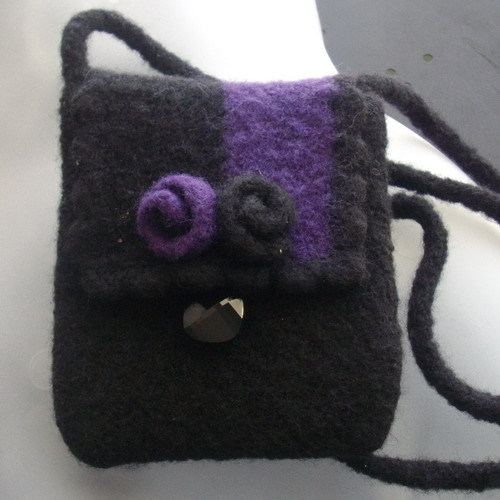 New wool necessities purse in black and purple with button fastening