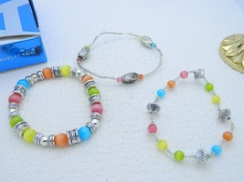 VTG 2007 AVON Cat's Eye Bracelet Trio Silver Tone Multi-Color Elastic - $11.88