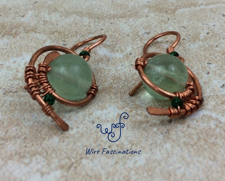 Handmade green fluorite earrings: copper wire wrapped swirl
