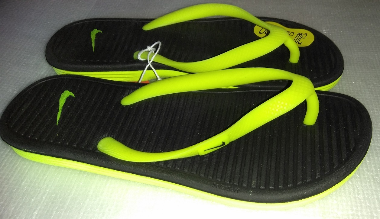 88090b9422e54 Nike Solarsoft Thong 2 Solid Black Vivid Volt Sandals Girl s Sandals Size 4Y