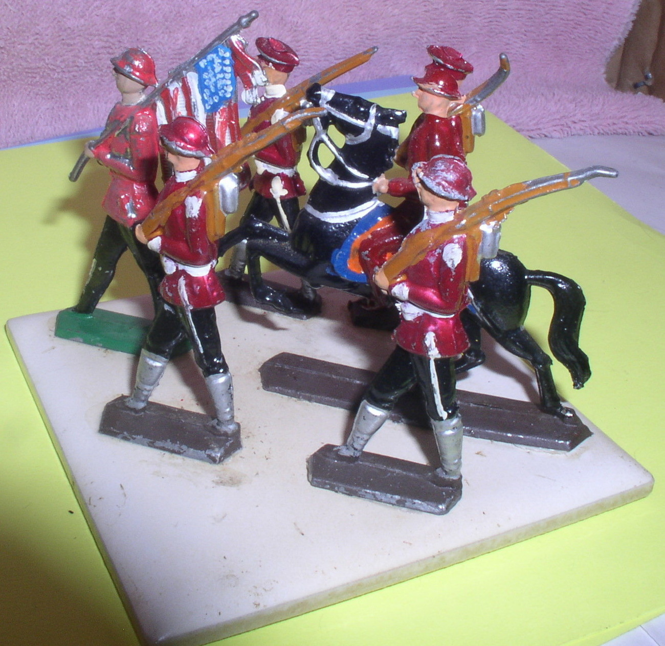 6 Lead  American soldiers hand painted on a tile which is marked Japan