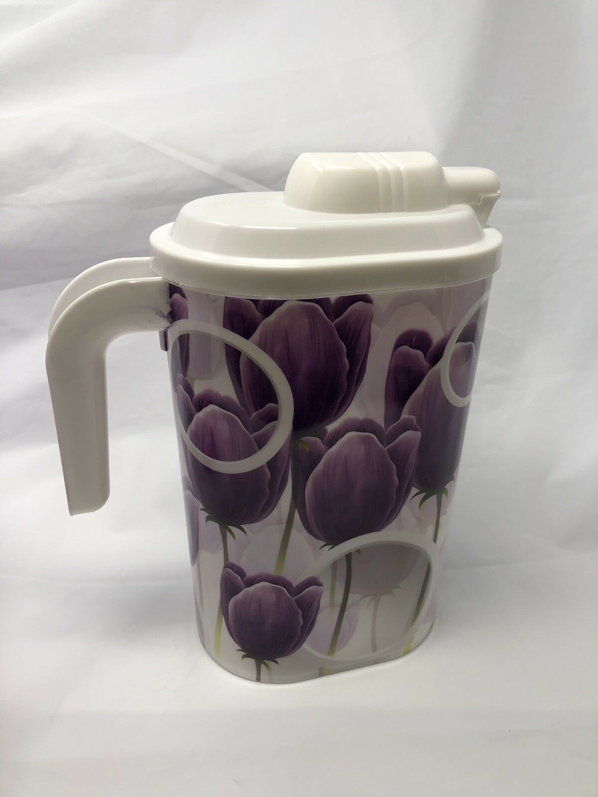 Purple Plastic Water Pitcher With Four Glasses Matching Color Theme
