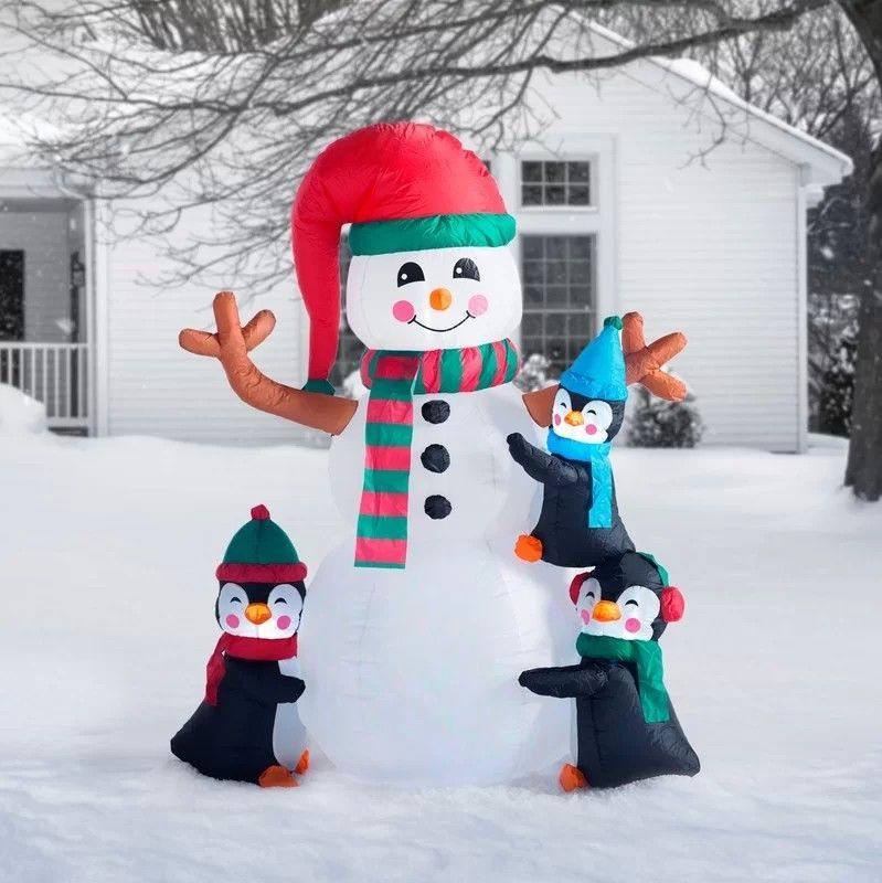 Primary image for NEW 6ft Christmas Inflatable Penguins Making Snowman Lighted Yard Decor Outdoor