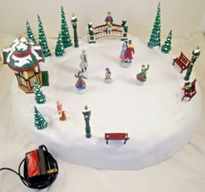 Mr Christmas Holiday Skaters Moving & Musical 15 Songs - $148.49
