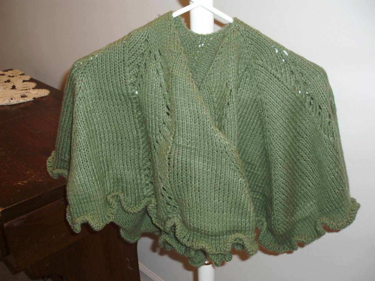 Green knit shawl with lace motif