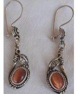 Brown cat eye  mini dangling  earrings - $25.00