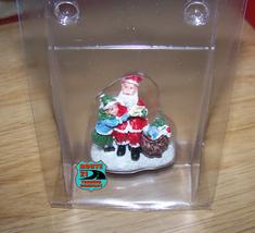 Single Christmas Village figurine Santa with girl and bag of gifts - $8.00