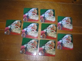 Lot of 8 Vintage Reproduction Santa Claus Drinking Coca-Cola Square Cork Backed  - $9.49