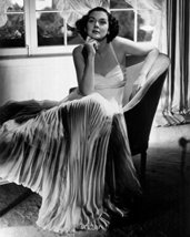Rosalind Russell Relaxing In Flowing Gown On Chair 16X20 Canvas Giclee - $69.99