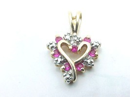 Vintage HEART PENDANT with 7 RUBIES in 10K Yellow GOLD VERMEIL on STERLING  - $52.00