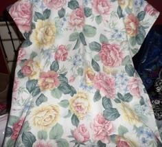 """White tablecloth 56"""" x 104"""" with mauve, yellow and blue flowers, green l... - $26.50"""