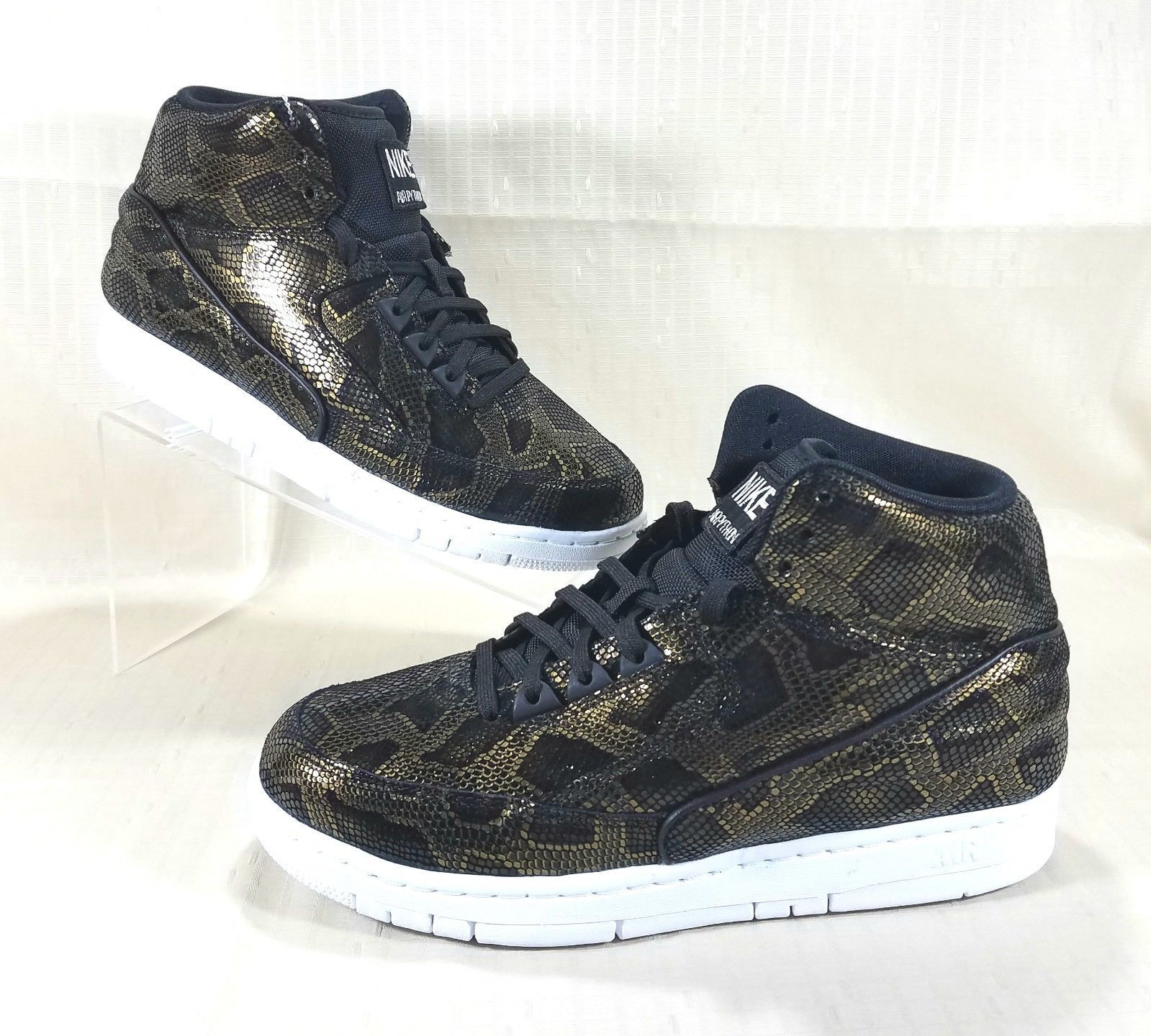 new product 7eb08 6b6c5 S l1600. S l1600. Nike Air Python Premium Sneakers Men s Size 9 Black   Metallic  Gold 705066-002
