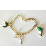 Vintage Sterling Silver Charm Braclet with Three Sterling Dolphin Charms... - $44.99