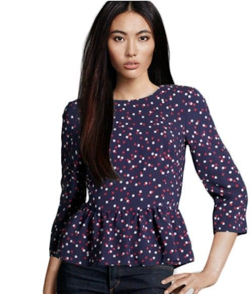 A white button-down is a wardrobe basic, but polka dots take it to the next level! This is a great blouse to wear with your basics, like a black skirt, jeans, colored trousers, or even overalls.