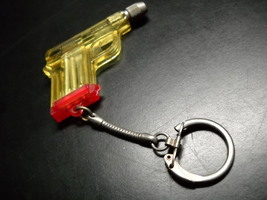 Key Chain Screwdriver Gun with Three Attachements Red Yellow Made in Hong Kong - $9.99