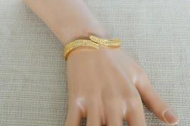 Lovely vintage shell patterned gold tone clamper cuff bracelet - $15.00
