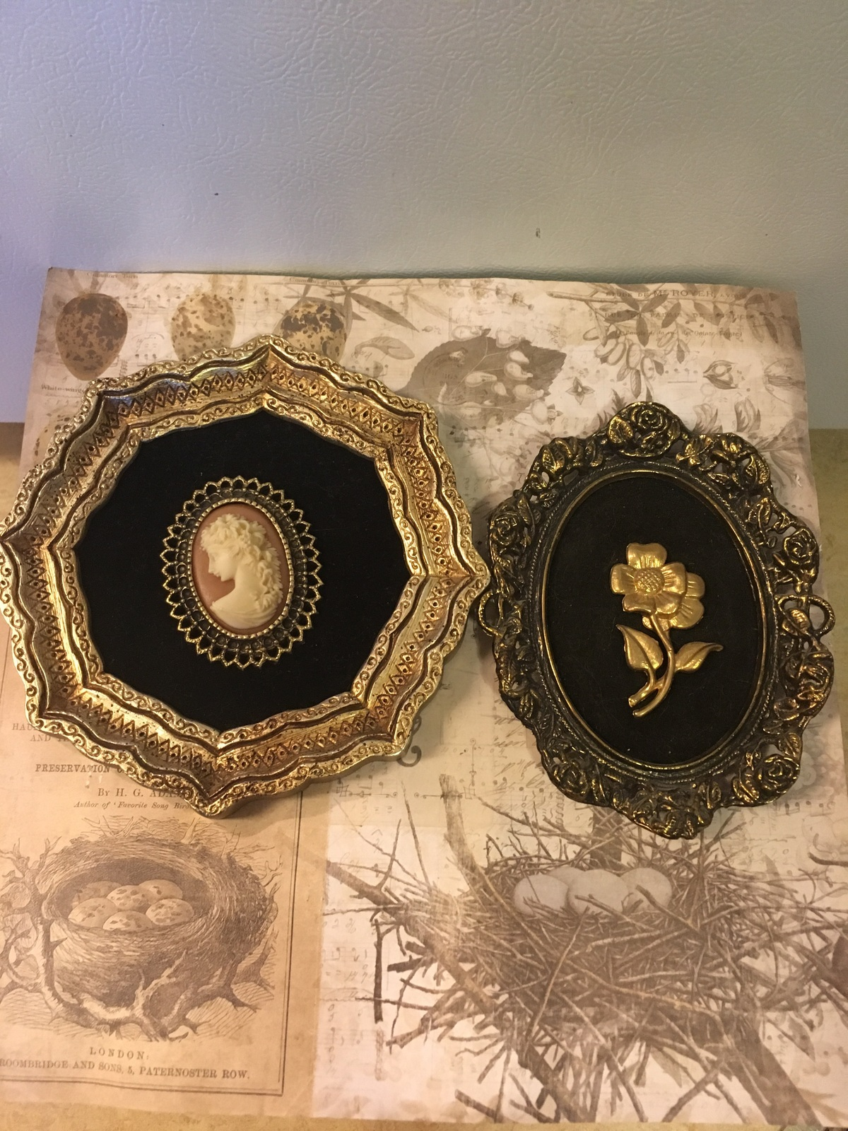 Set of Two Black & Gold Cameo Like Wall Hangings