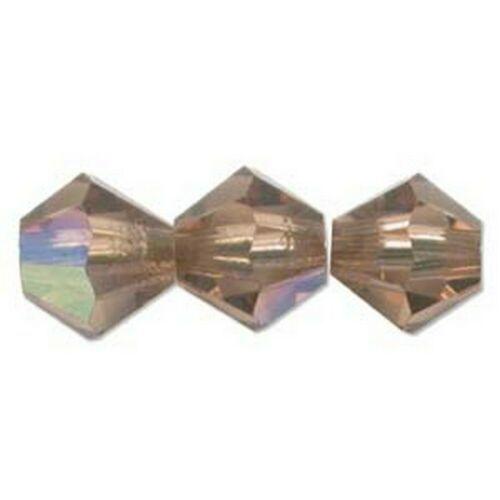 Swarovski Crystal Beads 5328 6mm Smk Lt Topaz  Bicone (Pack of 24) - $9.85