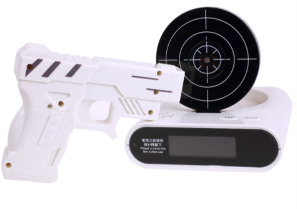 Primary image for LCD Laser Gun Shooting Target Wake UP Alarm Desk Clock Novelty Gadget Fun Toy