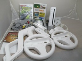 Nintendo Wii Console Bundle RVL-001 Two Controllers Zapper 3 Games Wheel Manual  - $119.00
