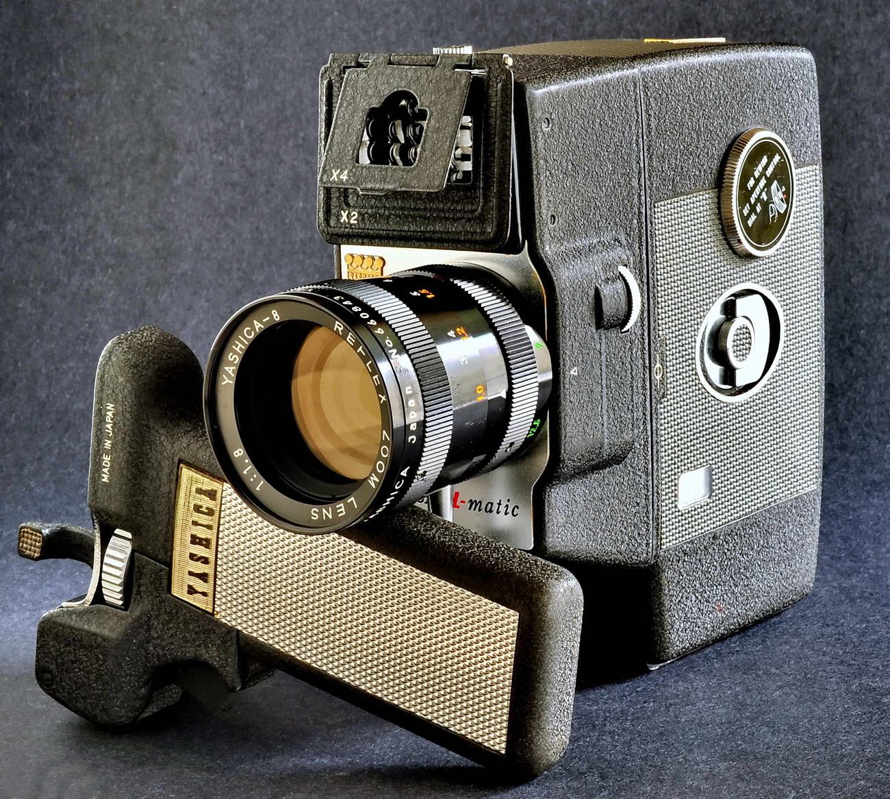 Yashica 8 u matic yashinon 9 28 f1.8 reflex zoom lens w handle.2.small file