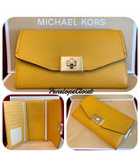 NWT MICHAEL KORS PEBBLED LEATHER CASSIE LARGE TRIFOLD WALLET IN MARIGOLD - $65.77 CAD