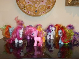 HASBRO LOT OF 11 COLORFUL 2010 MY LITTLE PONYS - $99.00