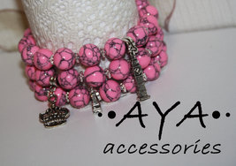 A set of bracelets pink turquoise Big Ben crown Eiffel Tower charm - $42.00