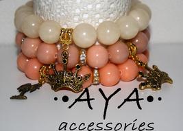 A set of bracelets orange jade quartz crown palm tree charm - $41.00