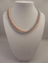Elegant, Two Strand, Half Twisted Necklace with 6mm Gray & Peach Glass P... - $30.00