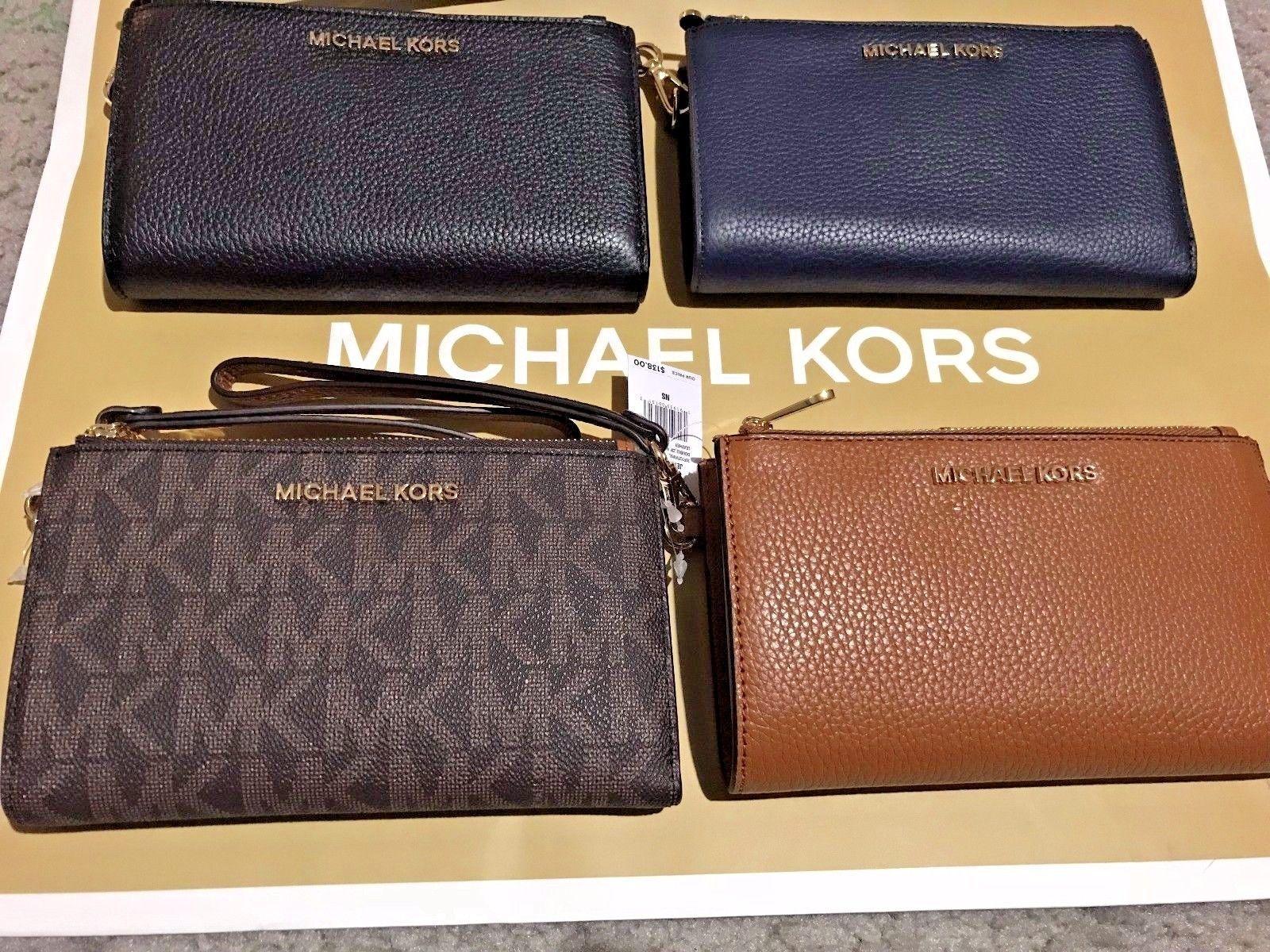 78fe4082737e S l1600. S l1600. Previous. NWT Michael Kors Leather PVC Jet Set Travel  Double Zip Wallet Wristlet ...
