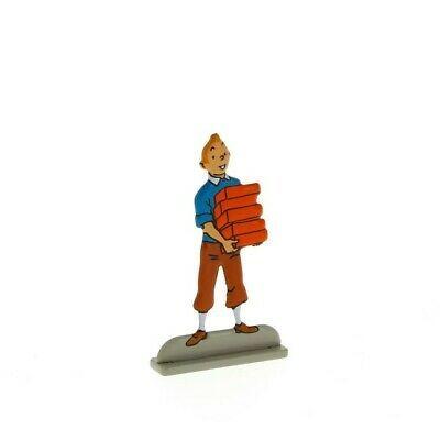 Tintin carrying bricks metal figurine