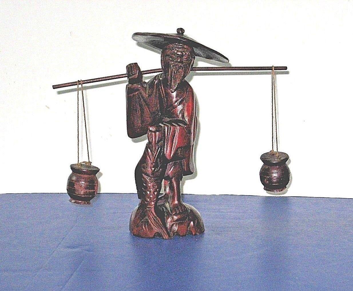 ASIAN CARVING:   Old Man Balancing Pots While Carrying Big Fish