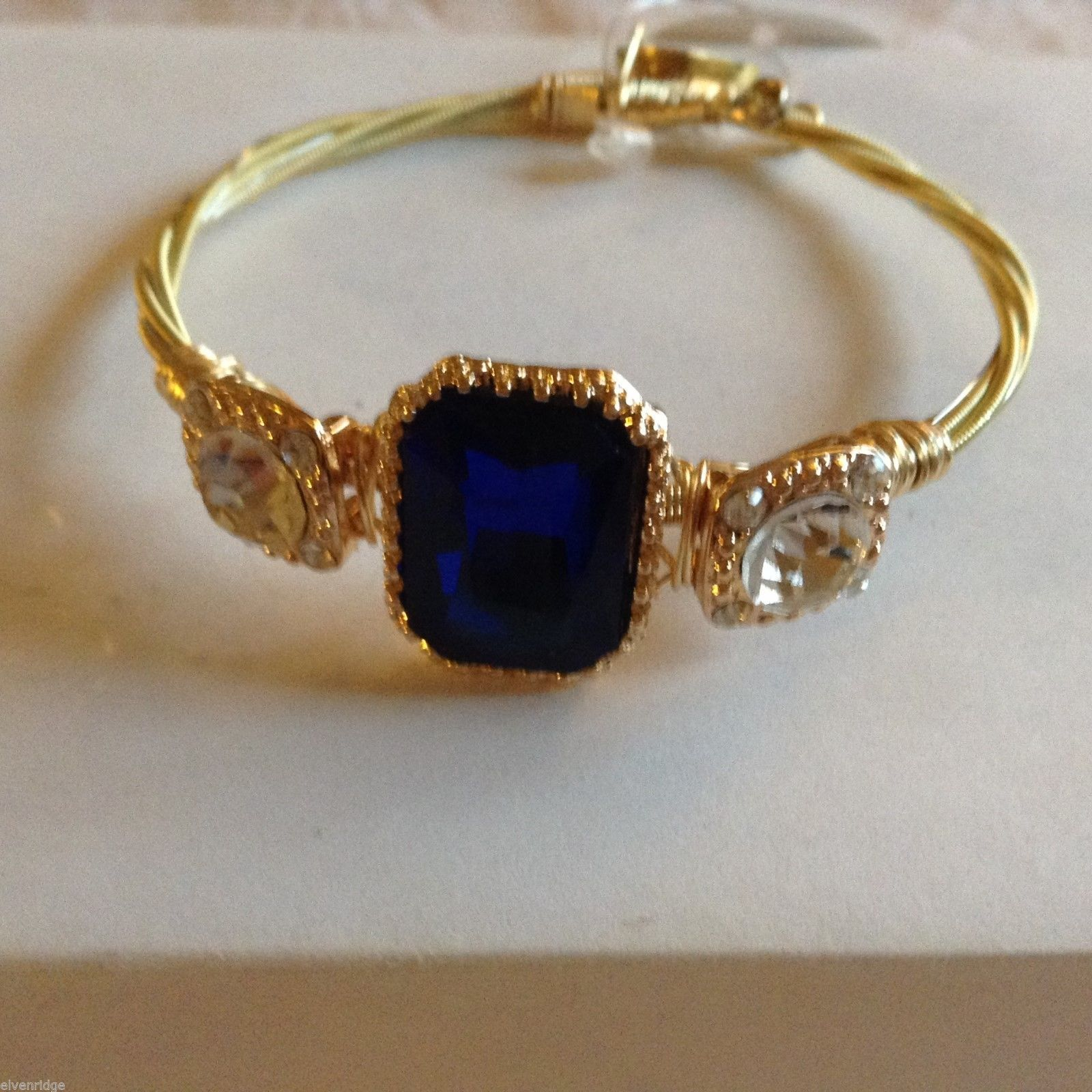 String Theory Guitar Strings Gold Bracelet w/ a Royal Blue Stone, Size 7 1/2